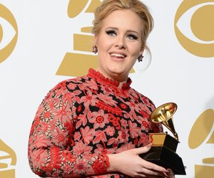 """Adele poses with her trophy for Best Pop Solo Performance for """"Set Fire To The Rain"""" in the press room at the Staples Center during the 55th Grammy Awards in Los Angeles, California, February 10, 2013. AFP PHOTO Robyn BECK (Photo credit should read ROBYN BECK/AFP/Getty Images)"""