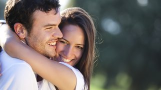 Closeup on young beautiful smiling couple.