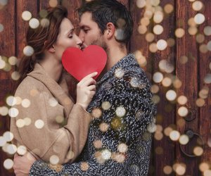 outdoor couple holding heart in february