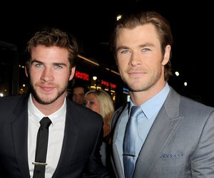 "HOLLYWOOD, CA - NOVEMBER 04: Actors Liam Hemsworth (L) and Chris Hemsworth arrive at the premiere of Marvel's ""Thor: The Dark World"" at the El Capitan Theatre on November 4, 2013 in Hollywood, California. (Photo by Kevin Winter/Getty Images)"
