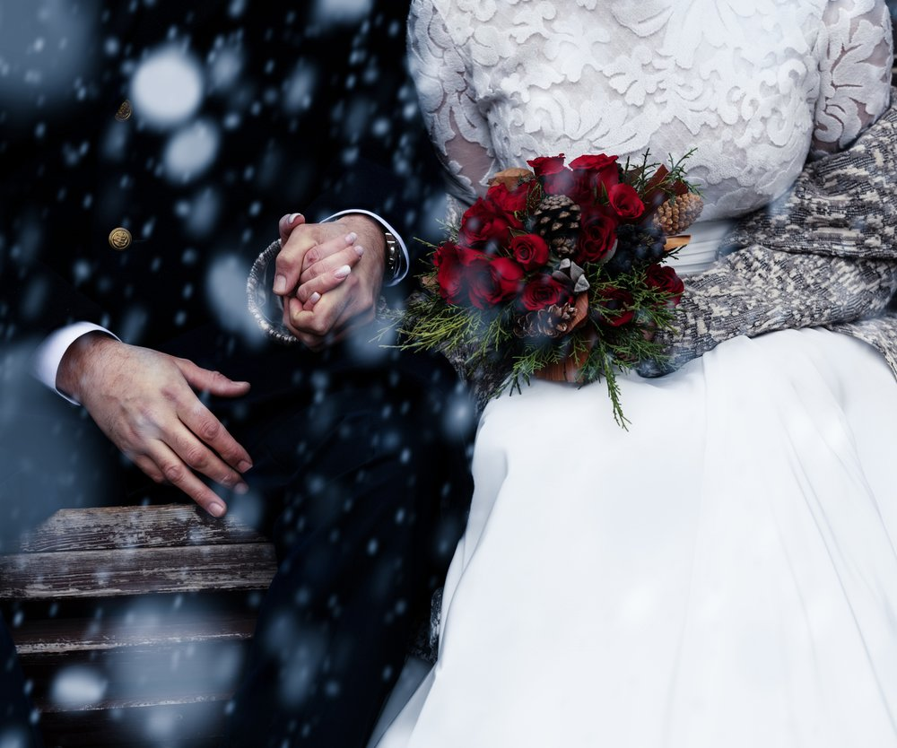 Happy bride and groom enjoying romantic moments outdoors. Wedding couple.Winter concept.