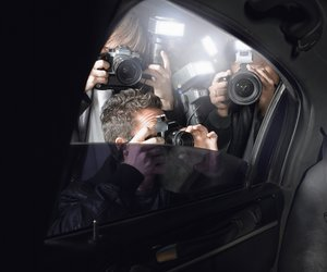 Paparazzi taking pictures through car window