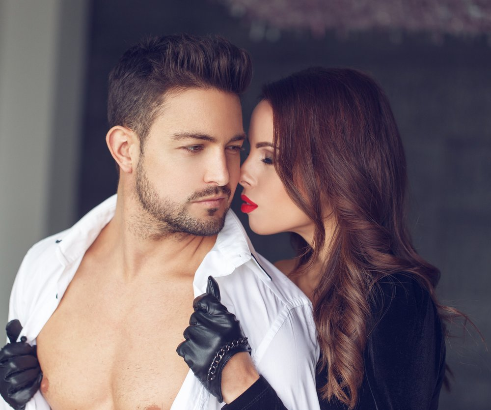 Woman undress young macho lover indoor