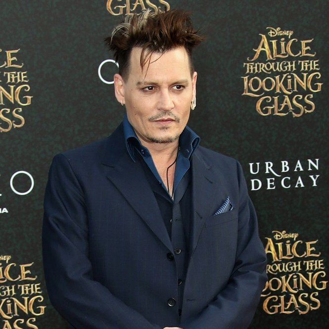 "HOLLYWOOD, CA - MAY 23:  Actor Johnny Depp attends the premiere of Disney's ""Alice Through The Looking Glass at the El Capitan Theatre on May 23, 2016 in Hollywood, California.  (Photo by Frederick M. Brown/Getty Images)"