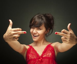 Girl showing her middle fingers