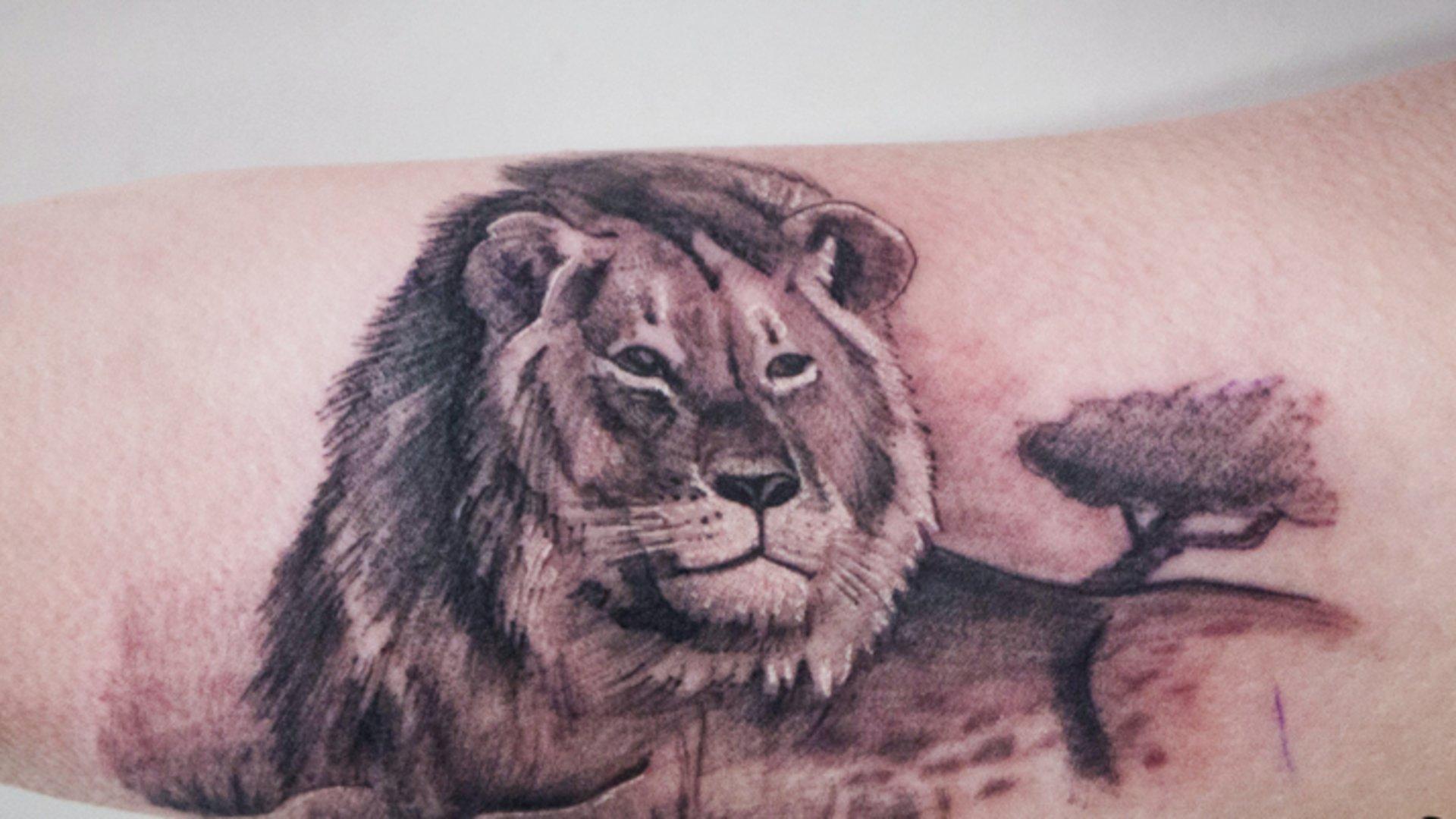 Frau mit tigerkopf tattoo bedeutung