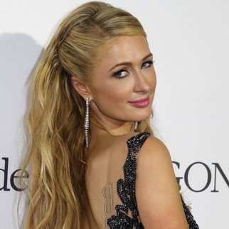US socialite Paris Hilton attends the De Grisogono Party on the sidelines of the 68th annual Cannes Film Festival, at the Eden Roc hotel in Antibes, near Cannes, southeastern France, on May 19, 2015. AFP PHOTO / JEAN CHRISTOPHE MAGNENET (Photo credit should read JEAN CHRISTOPHE MAGNENET/AFP/Getty Images)