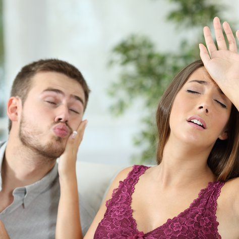 Woman pretending headache to avoid sex with her insistent boyfriend