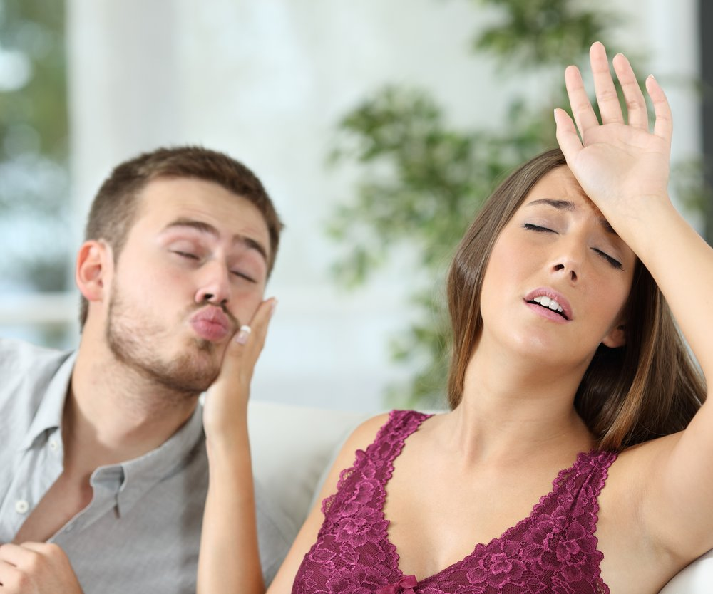Woman pretending headache to avoid sex with her insistent boyfriend