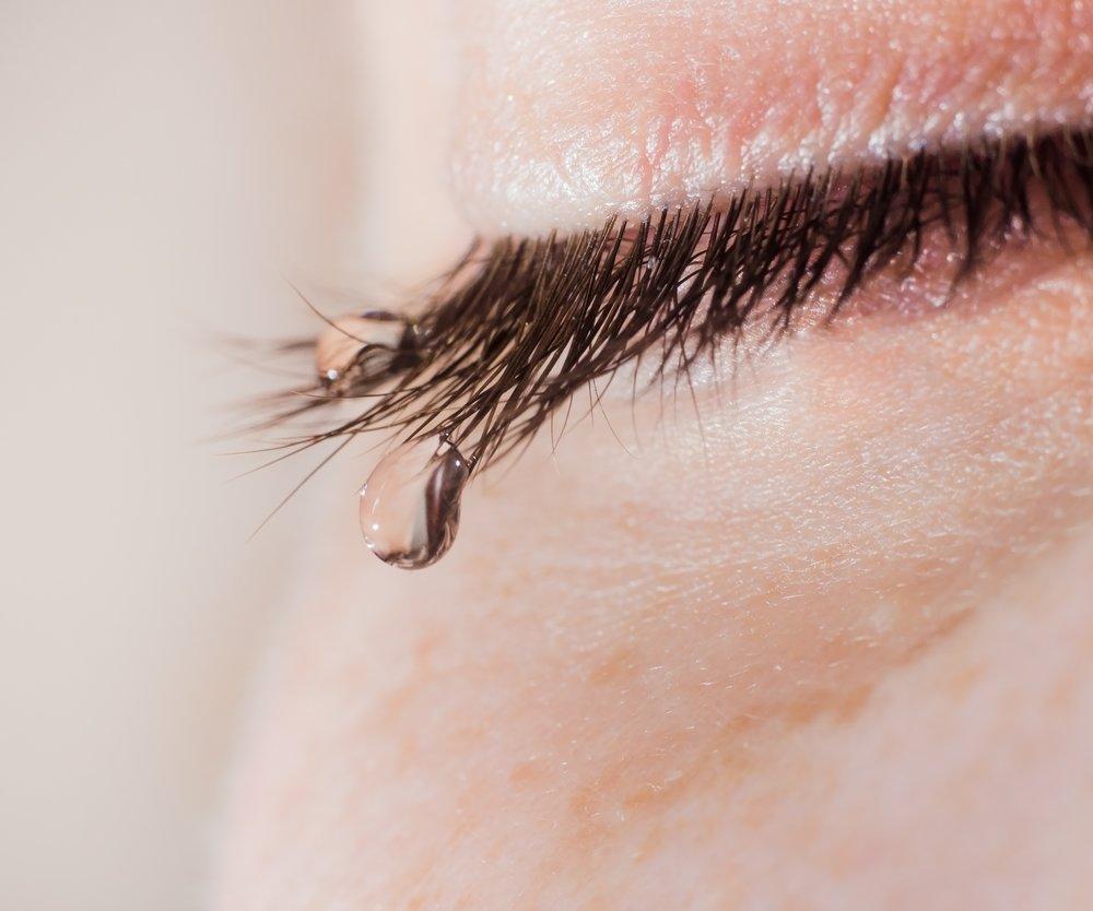 A tear on eyelashes closeup.