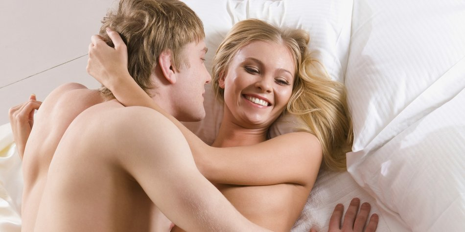 Photo of happy husband and wife enjoying themselves in bed