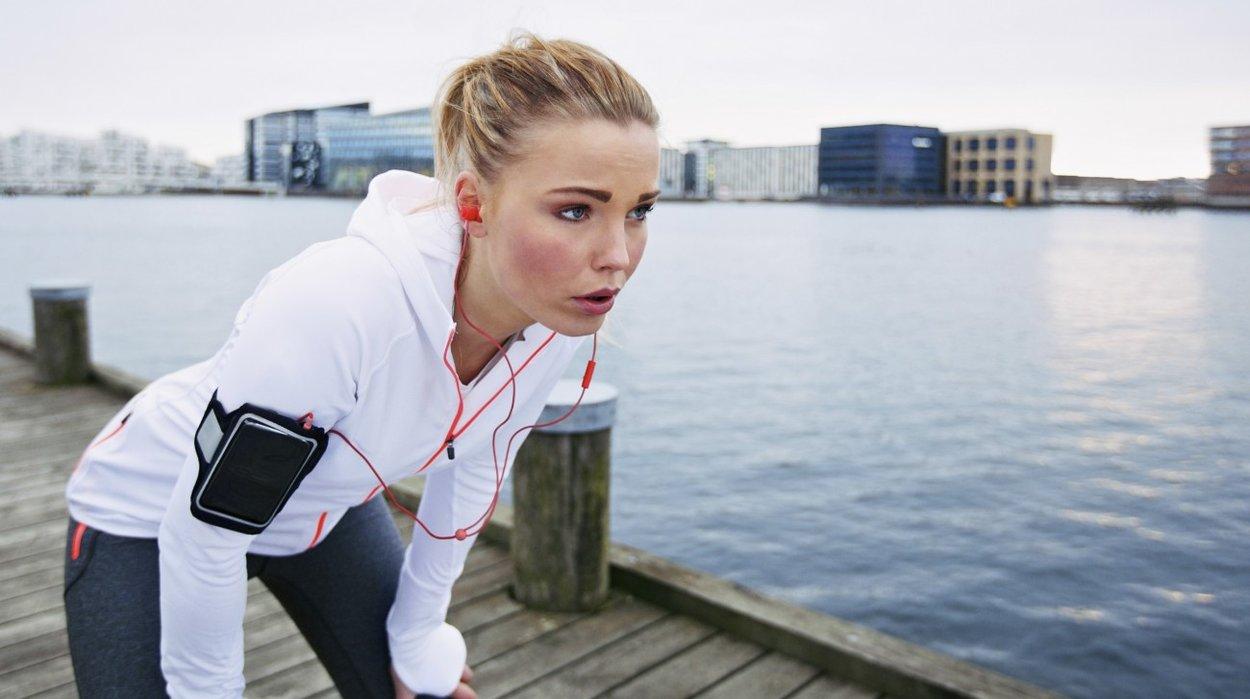 Woman taking a break while running