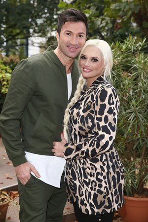 DUESSELDORF, GERMANY - OCTOBER 13:  Lucas Cordalis and Daniela Katzenberger pose for a photograph during the launch of her new book 'Eine Tussi wird Mama' on October 13, 2015 in Duesseldorf, Germany.  (Photo by Andreas Rentz/Getty Images)