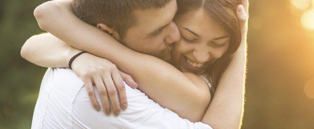Embracing loving couple outside