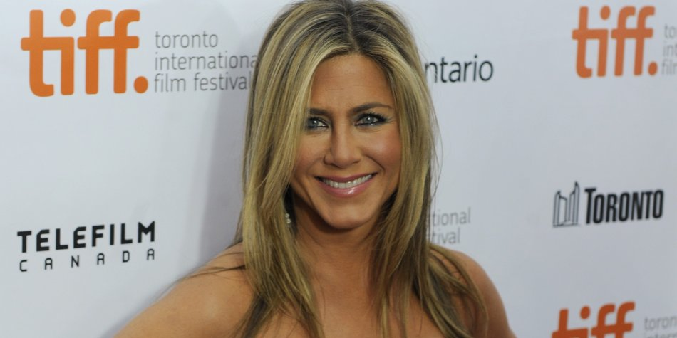 "TORONTO, ON - SEPTEMBER 14: Actress/producer Jennifer Aniston arrives at the ""Life Of Crime"" Premiere during the 2013 Toronto International Film Festival at Roy Thomson Hall on September 14, 2013 in Toronto, Canada. (Photo by Jag Gundu/Getty Images)"