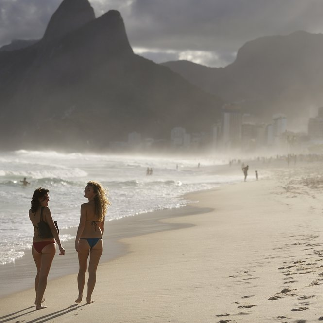 "Rio de Janeiro, Brazil - April 10, 2010: Ipanema Beach, the world famous beach, widely know by the song ""The Girl from Ipanema"", bossa nova song written by Antonia Carlos Jobim and Vinicius Moraes, Rio de Janeiro, Brazil"