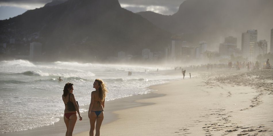 "Rio de Janeiro, Brazil - April 10, 2010: Ipanema Beach, the world famous beach, widely know by the song ""The Girl from Ipanema"", bossa nova song written by Antonia Carlos Jobim and Vinicius Moraes, Rio de Janeiro, Brazil"