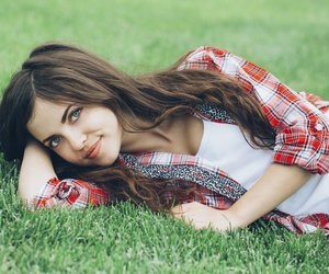Beautiful girl student resting on the grass.