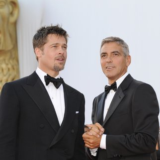 """US actors Brad Pitt (L) and George Clooney pose before the screening of the movie movie """"Burn After Reading"""" directed by Ethan and Joel Coen during the 65th Venice International Film Festival at Venice Lido, on August 27, 2008. """"Burn After Reading"""" is presented out of competition. AFP PHOTO DAMIEN MEYER (Photo credit should read DAMIEN MEYER/AFP/Getty Images)"""