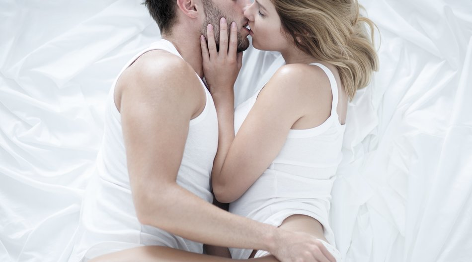 Photo of young man and woman cuddling in love