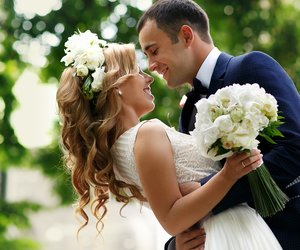 cant groom bride with a bouquet and a wreath in the park
