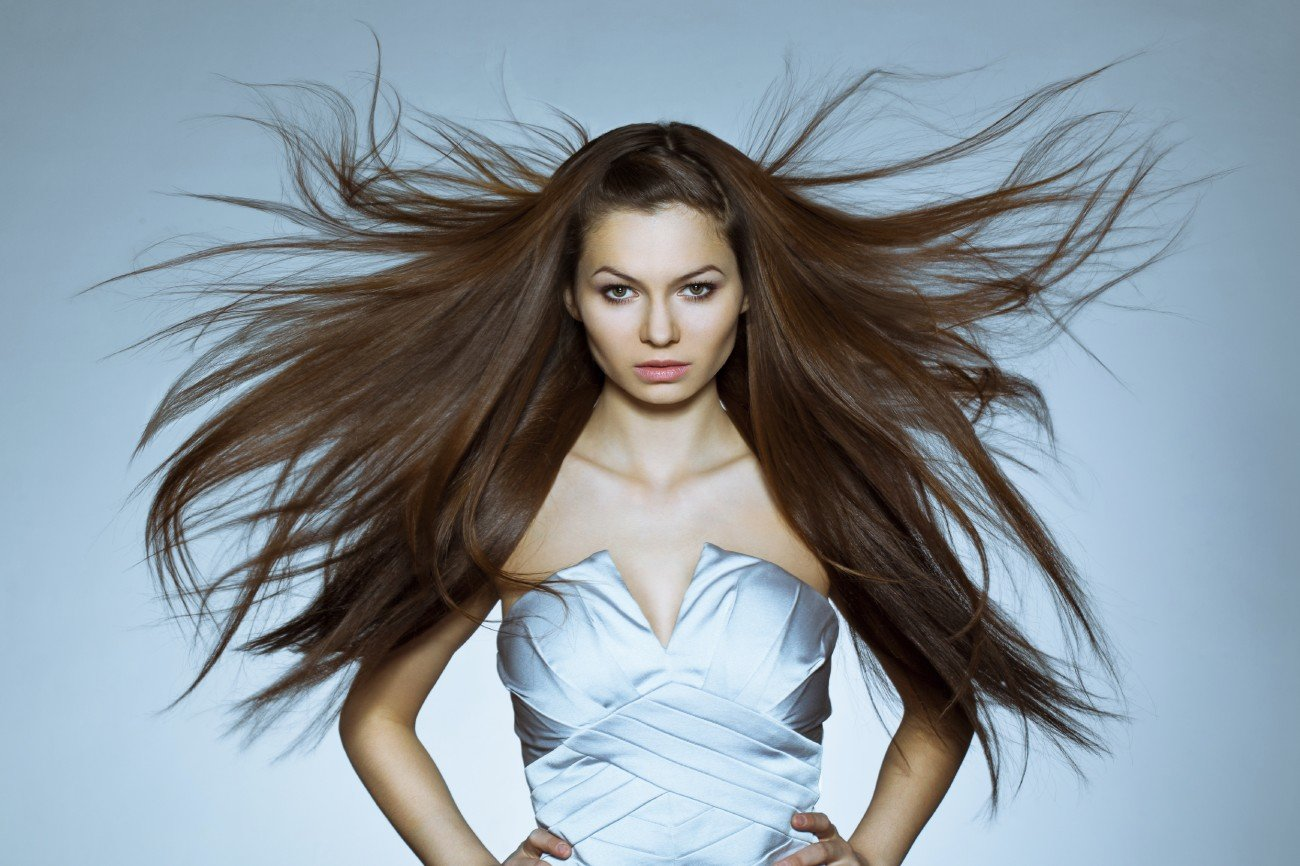 studio portrait of woman with flying hair