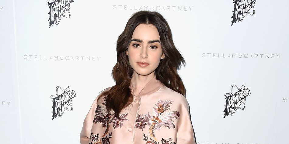 LOS ANGELES, CA - JANUARY 12: Actress Lily Collins arrives at Stella McCartney Autumn 2016 Presentation at Amoeba Music on January 12, 2016 in Los Angeles, California. (Photo by Frazer Harrison/Getty Images)