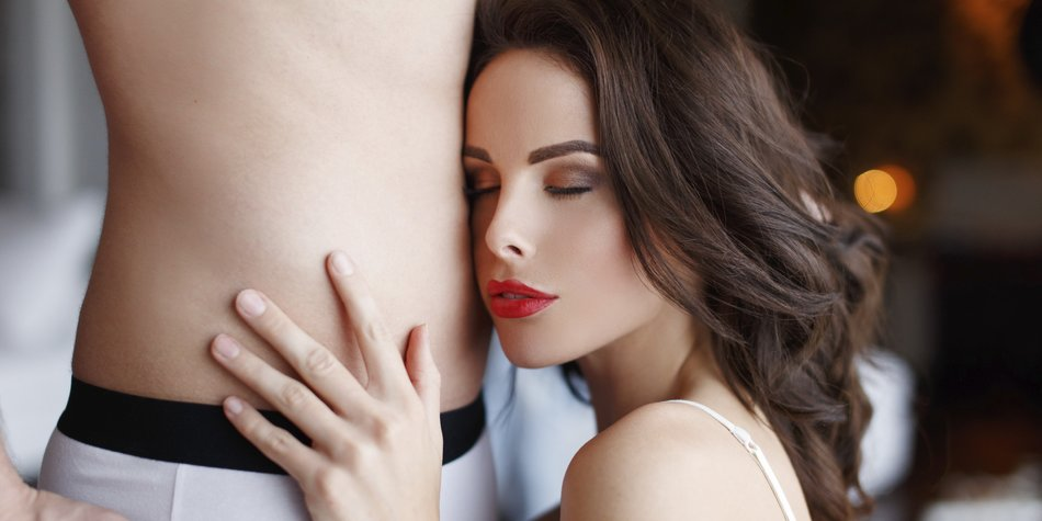 Sexy woman with young lover closeup, indoor portrait, desire