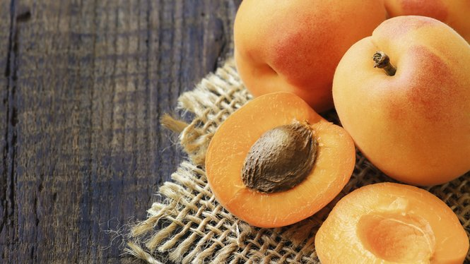 Fresh ripe apricots on a rustic wooden table