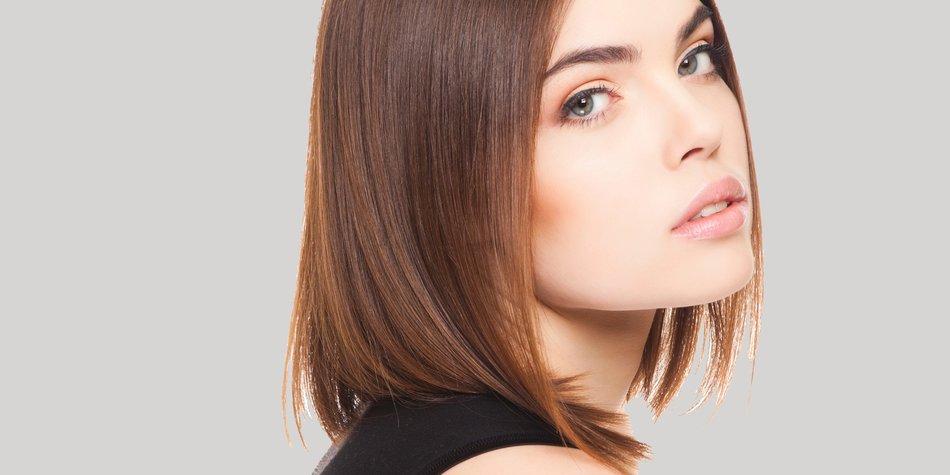 attractive caucasian female posing in studio on white background