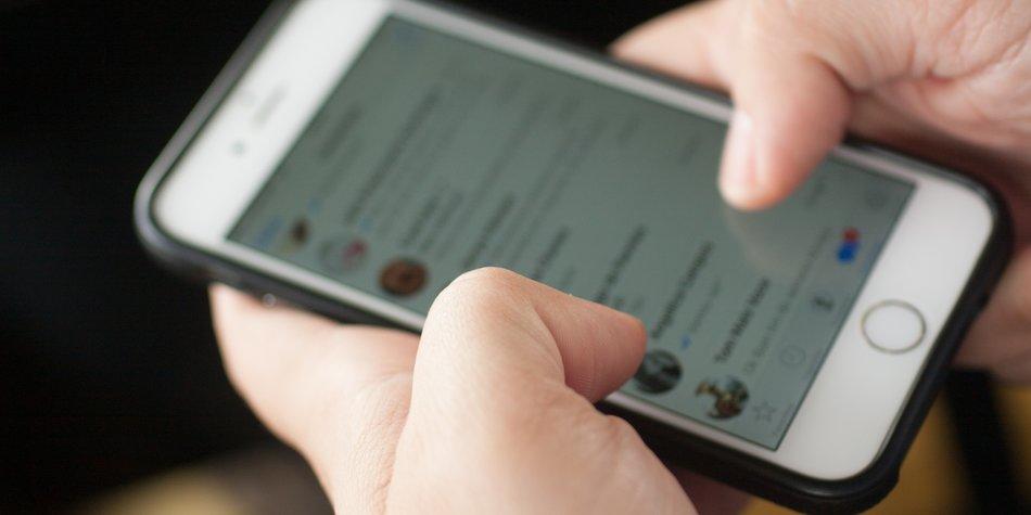 Rio de Janeiro, Brazil - June 4, 2016: Men typing in Whatsapp or text mensage