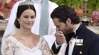 Sweden's Prince Carl Philip (R) kisses Sofia Hellqvist's hand during their wedding ceremony at the Royal Chapel in Stockholm Palace on June 13, 2015. AFP PHOTO / TT NEWS AGENCY / CLAUDIO BRESCIANI SWEDEN OUT (Photo credit should read Claudio Bresciani/AFP/Getty Images)