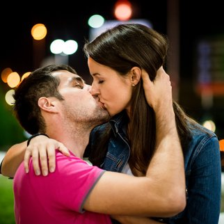 Couple together on date in street with neon lights at night
