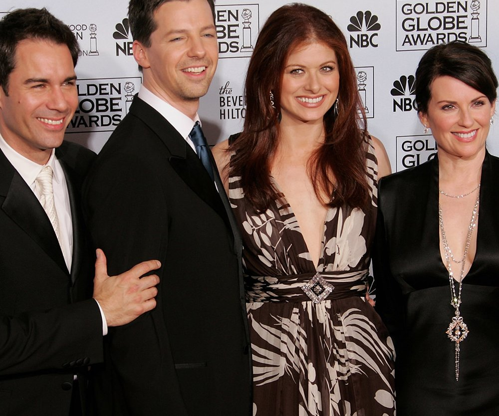 """BEVERLY HILLS, CA - JANUARY 16: The cast of """"Will & Grace"""" (L-R) actors Eric McCormack, Sean Hayes, Debra MEssing and Meghan Mullally pose backstage during 63rd Annual Golden Globe Awards at the Beverly Hilton on January 16, 2006 in Beverly Hills, California. (Photo by Kevin Winter/Getty Images)"""