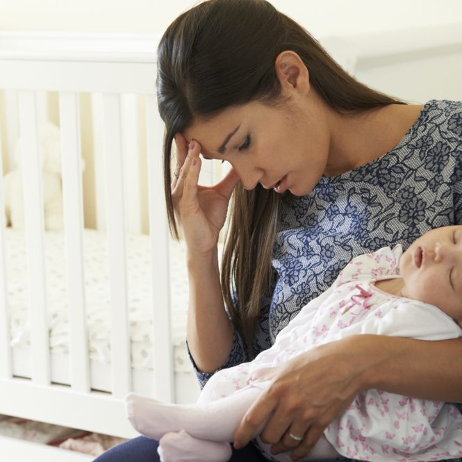 Tired Mother Suffering From Post Natal Depression