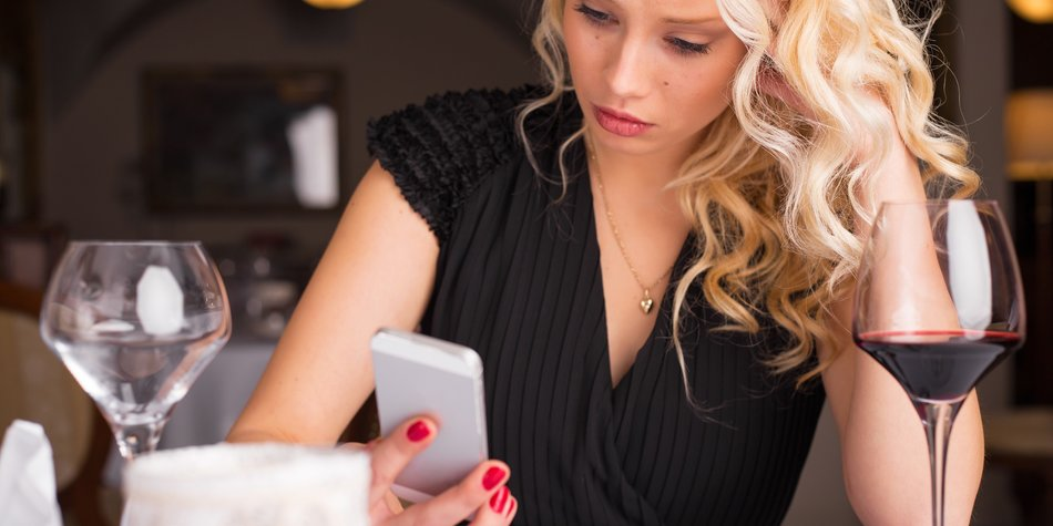 Worried woman looking at her phone