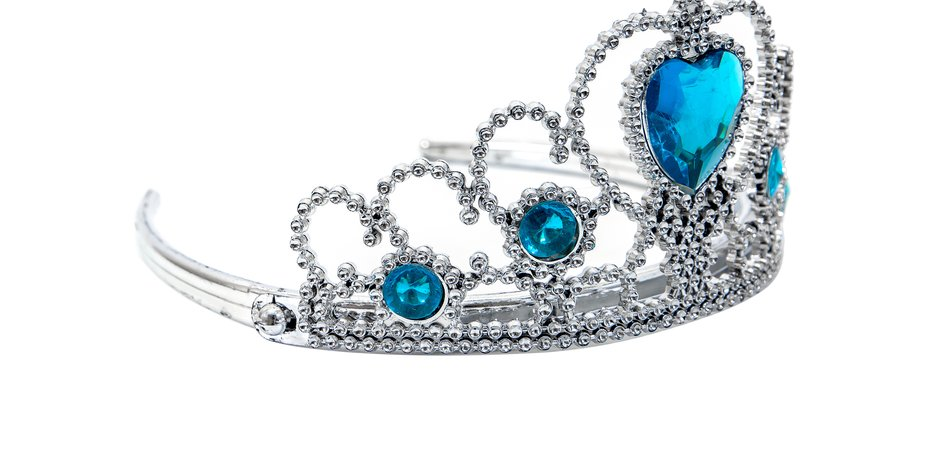 Plastic silver tiara toy isolated on white background.Toy crown isolated