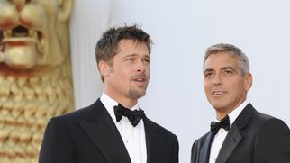 "US actors Brad Pitt (L) and George Clooney pose before the screening of the movie movie ""Burn After Reading"" directed by Ethan and Joel Coen during the 65th Venice International Film Festival at Venice Lido, on August 27, 2008. ""Burn After Reading"" is presented out of competition. AFP PHOTO DAMIEN MEYER (Photo credit should read DAMIEN MEYER/AFP/Getty Images)"