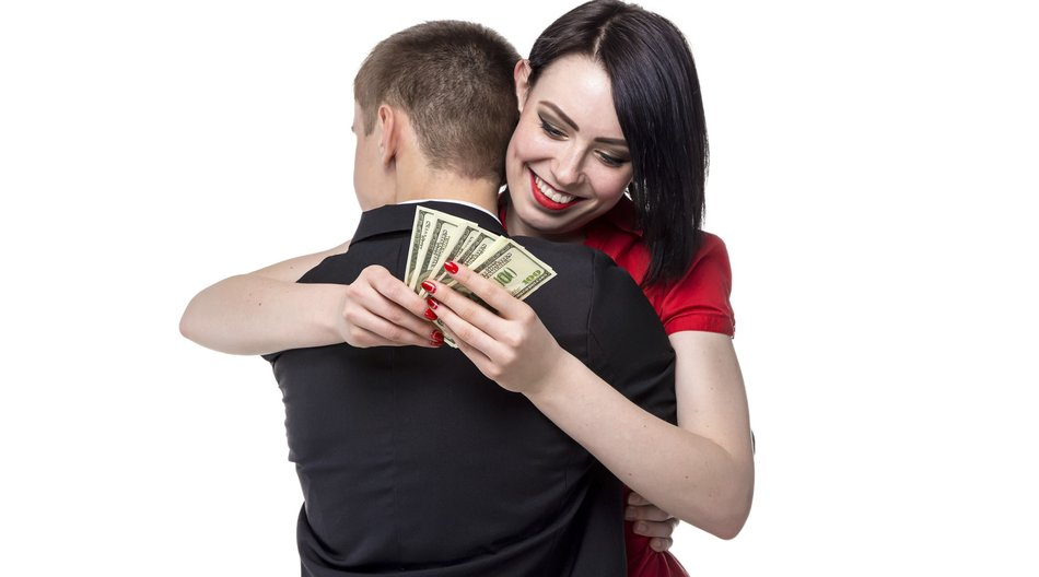 Man hugging woman with money. Isolated photo of people with white background.