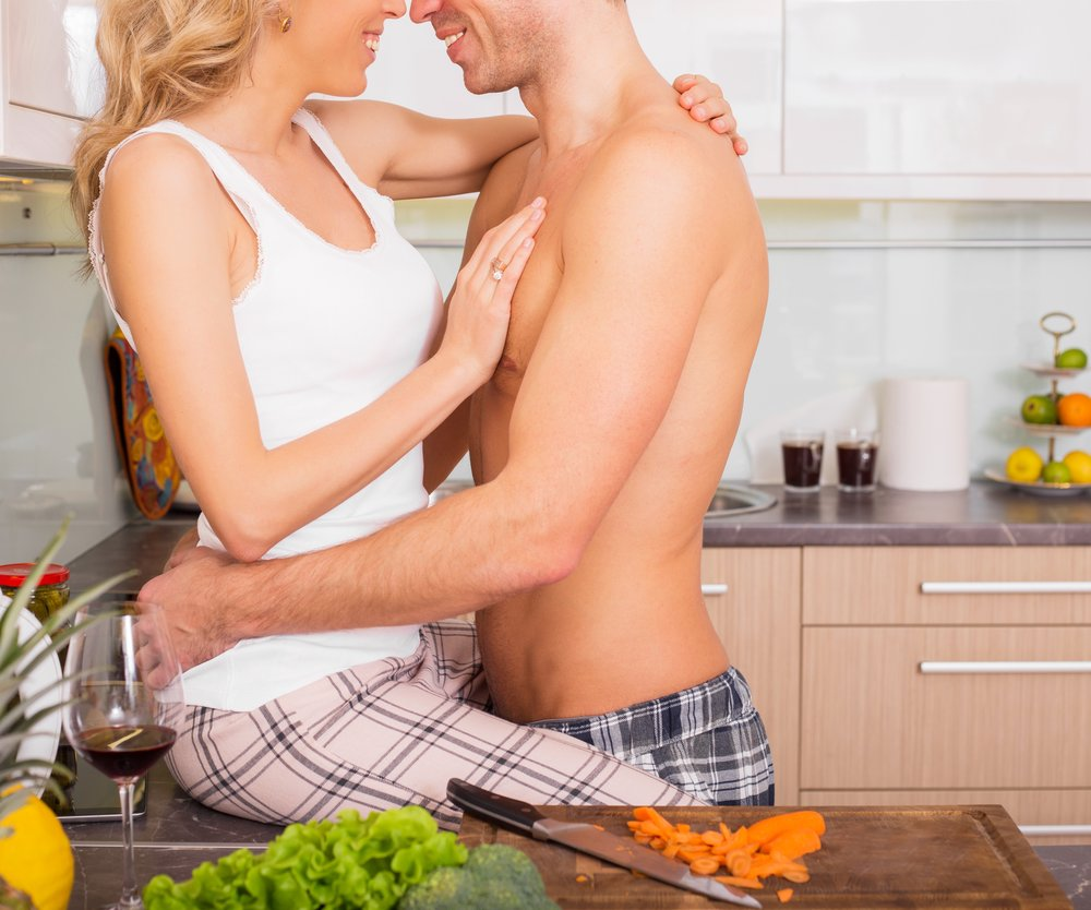Couple making out in kitchen