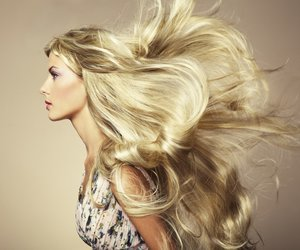 Photo of beautiful woman with magnificent hair. Fashion photo