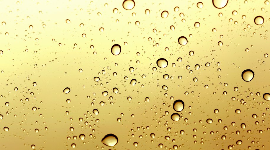 Gold water drop windshiled background.