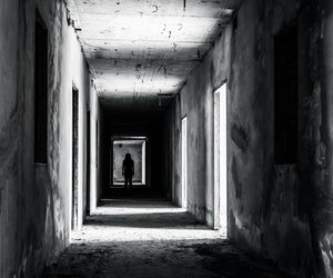 walkway in Abandoned building with scary woman inside, darkness horror and halloween background concept