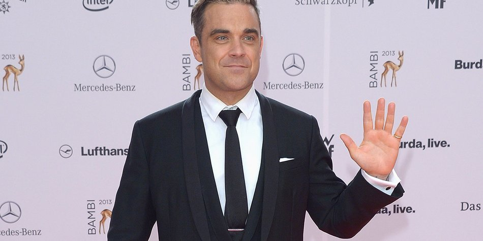 BERLIN, GERMANY - NOVEMBER 14: Robbie Williams attends the Bambi Awards 2013 at Stage Theater on November 14, 2013 in Berlin, Germany. (Photo by Luca Teuchmann/Getty Images)