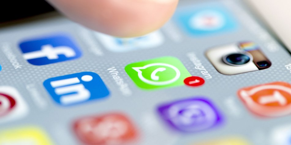 Istanbul, Turkey - September 18, 2015: Apple Iphone 6 screen with social media applications of Whatsapp, Facebook, Instagram, Viber, Linkedin, Tango, Perisfind and Snapchat while a male finger is about to touch on Whatsapp app.