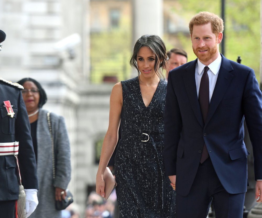 LONDON, ENGLAND - APRIL 23: Prince Harry and Meghan Markle arrive at a memorial service at St Martin-in-the-Fields in Trafalgar Square to commemorate the 25th anniversary of the murder of Stephen Lawrence on April 23, 2018 in London, England.. The 18-year-old murder victim was fatally stabbed by a gang of racists in Eltham, south-east London, on April 22 1993. (Photo by Victoria Jones WPA Pool/Getty Images)