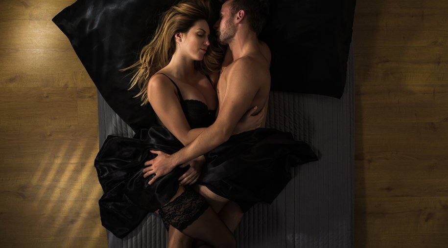 Passionate couple is cuddling after making love