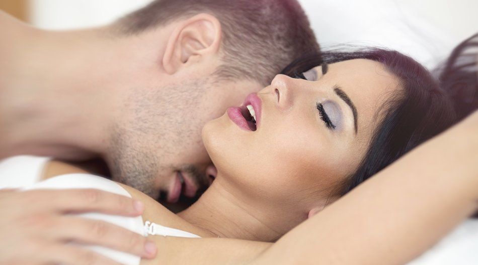 Man passionately engaged in sex with a beautiful girl
