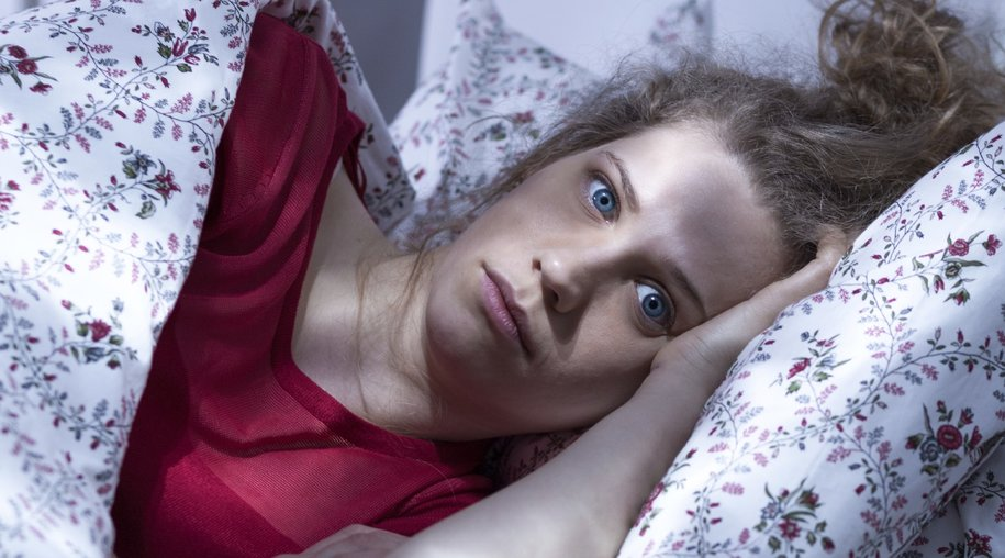 Image of young woman suffering from insomnia
