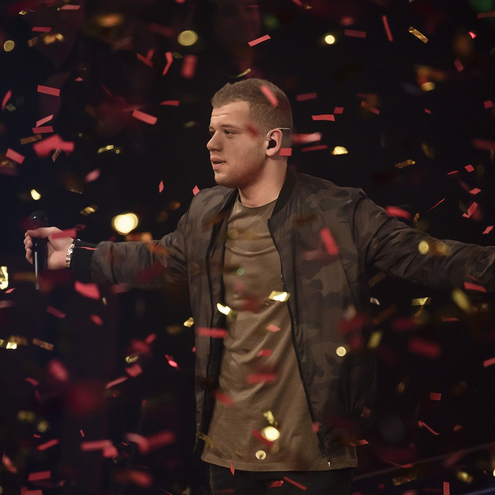 BERLIN, GERMANY - DECEMBER 18: Tay Schmedtmann celebrates during the ''The Voice Of Germany' Finals' on December 18, 2016 in Berlin, Germany. (Photo by Clemens Bilan/Getty Images)
